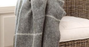 Grey checked Gotland Norwegian natural sheep wool blanket. Soft not coloured grey wool throw blanket with fringes. Big grey wool bed cover