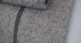 Personalise herringbone weave grey wool blanket with fringes. Grey natural not coloured wool bedspread 'Boteh 26' made in Europe