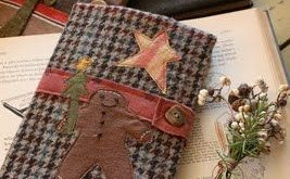 ~cover old books or journals with homespun material, glue or tack on felt cutout...