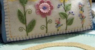 Felt flowers and embroidery pillow.