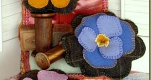 Pin Cushions - wool applique and freezer paper (tutorial) I have the yellow sunf...