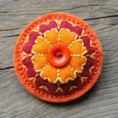 Felt and button brooches Flickr