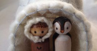 Felted ice cave with winter peg dolls and penguins