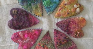 Handfelted brooches with hand stitching and beading.  www.tanyarogers.c...
