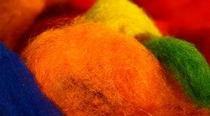 Raw wool is typically grey or black, but can be dyed before the felting process ...
