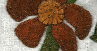 Diane Knott - Raw silk background, wool flower, merino wool/rayon stems stitched...